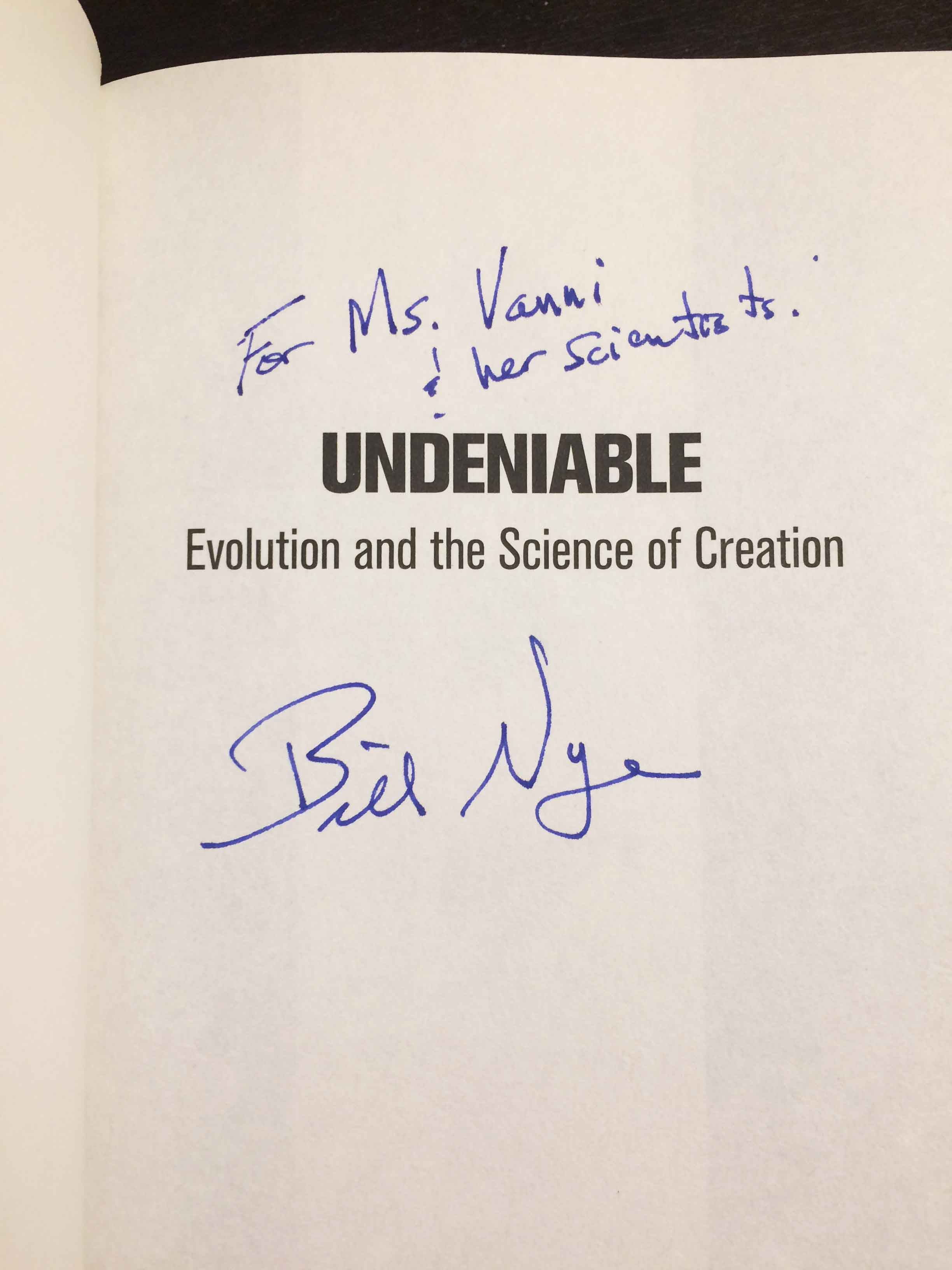 Bill Nye signs his book for Megan Vanni, mentioning her students at SMCHS.