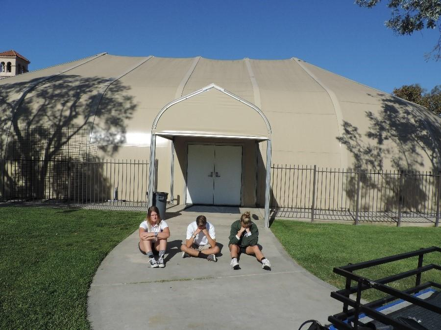 Seniors Sara Smith, Taylor Comroe and Maeve Gerrity sit in front of the Dome.