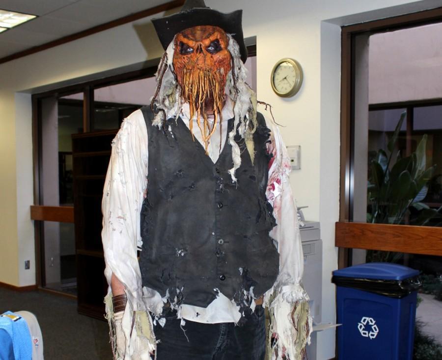 Art teacher Todd Robey dresses up as a pumpkin-headed cowboy.