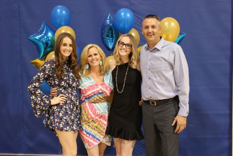 Family man - (L-R) Delaney ('17), Kelly, Carlie ('15) and Mike McCabe pose for a photo at the cheer banquet.
