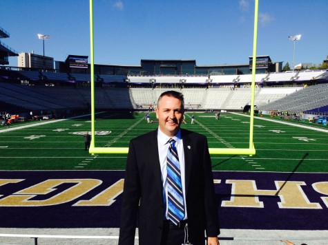 Calm before the storm - Mike McCabe at Husky Stadium prior to kickoff.