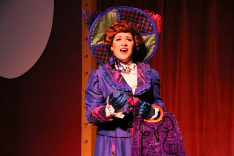 "Senior Andrea Martinez on stage performing as the lead character in ""Hello Dolly!""."