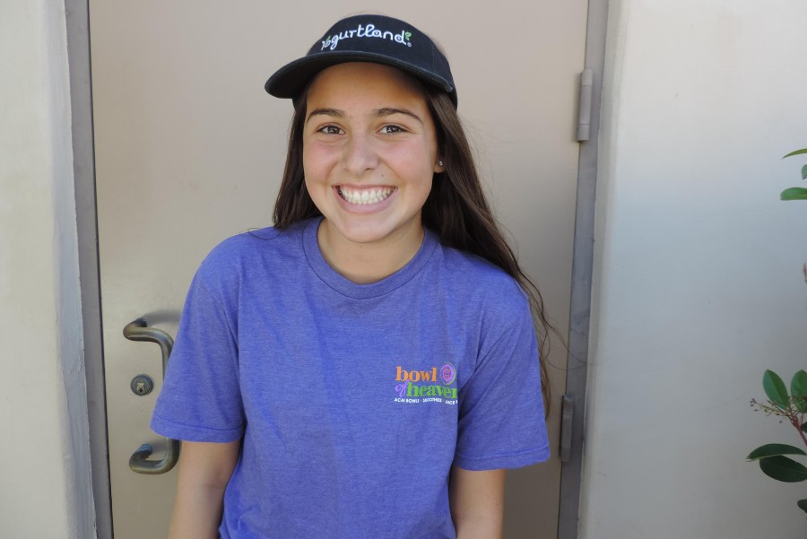 Junior Caitlin Carrillo changes into her Bowl of Heaven uniform right after school ends in order to get to work on time.