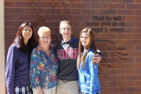 Eagle family - Seniors Yvonne Kim, Daniel Semeniuta and Katie Roschak pose for a picture with their two-year full-IB counselor Lyn Alexander.