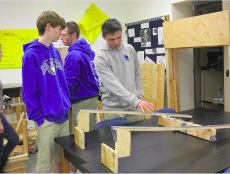Sophomore Jack Evans and senior Bryan Leonor discuss possible prototypes for the FRC robot.