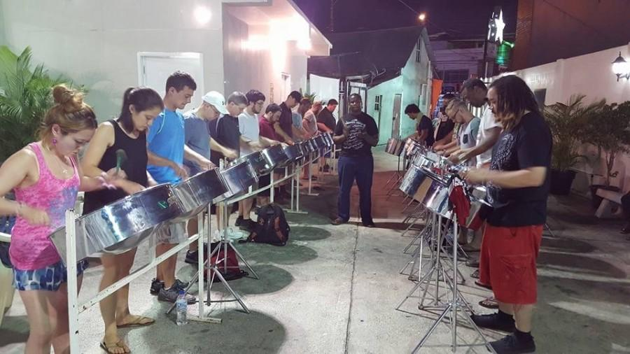 Amanda Duncan and the rest of the Silver Stars Orchestra practice the steel pan under the instruction of their arranger.