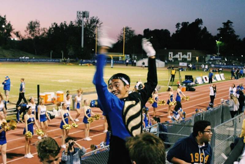 George+Tajonera+energizes+the+Eagle+Regiment+as+he+leads+them+in+rallying+for+the+SMCHS+football+team.+