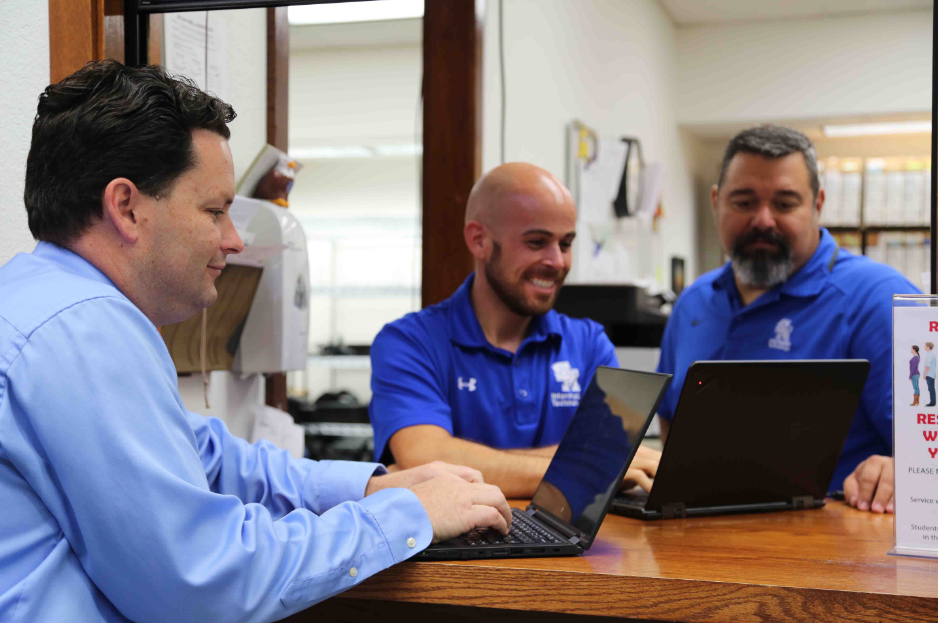 Scott Bricker (left), Kevin Hagan (middle) and Javier Hernandez (right) explore new ways to improve the tablet program.
