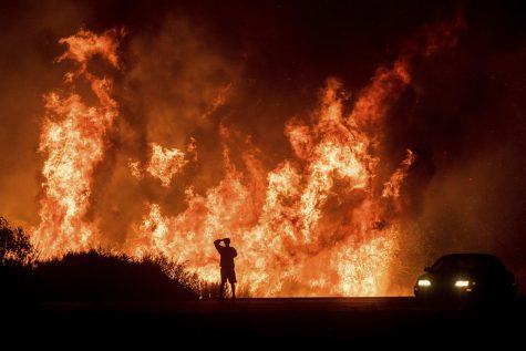 Southern California ablaze with wildfires, residents evacuate