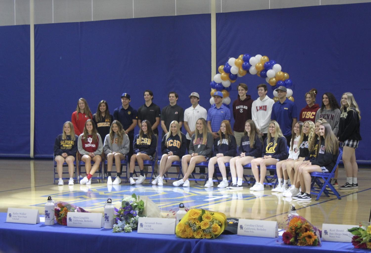 SM's 26 future collegiate athletes pose for a group picture after signing.