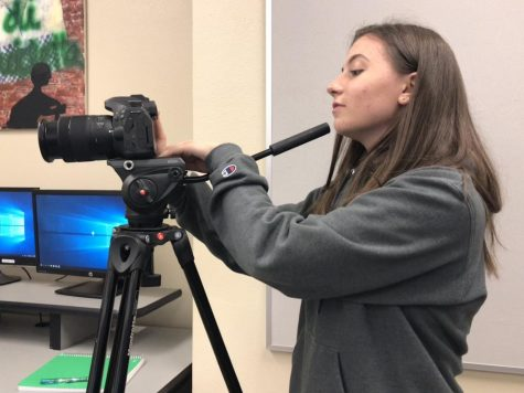 Markie takes a video for her Film class. Markie started out by creating iMovie videos with her friends in middle school.
