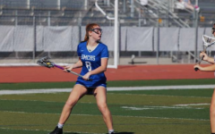 Freeborn plays in a lacrosse game last year. Playing multiple sports and keeping up with her schoolwork has taken a toll on the athlete's mental and physical health.
