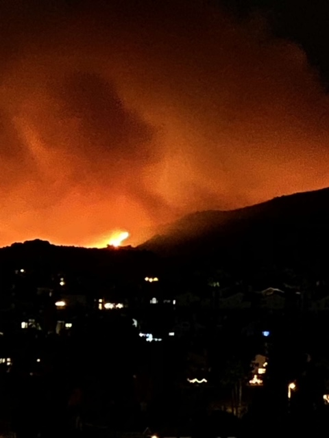 Sara Good captures the fire from a nearby park. Earlier that day, Good and her family had evacuated their home.