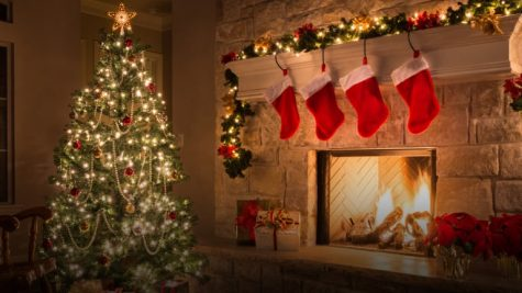 Stockings hang festively in an already decorated room. Though it is always fun to celebrate the holidays, we should consider saving the celebration for later.