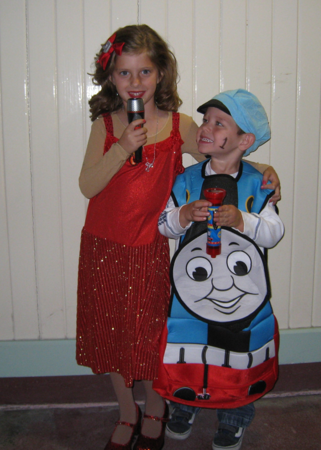 Johnson and her younger brother all dressed up and ready for a night full of receiving their favorite candies from houses around the block.