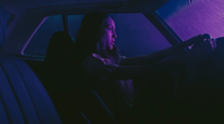 "Rising star Olivia Rodrigo drives a car through the suburbs in a music video for her new single ""Driver"