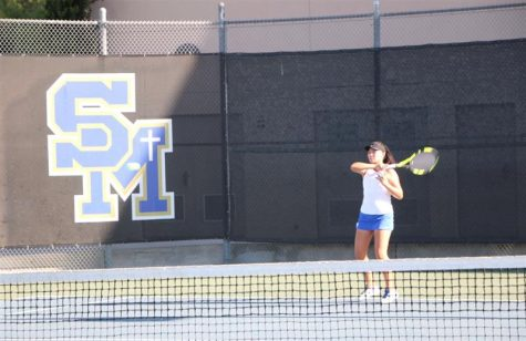 Vicky Zhang prepares to send the ball flying through the court as she practices for her matches.