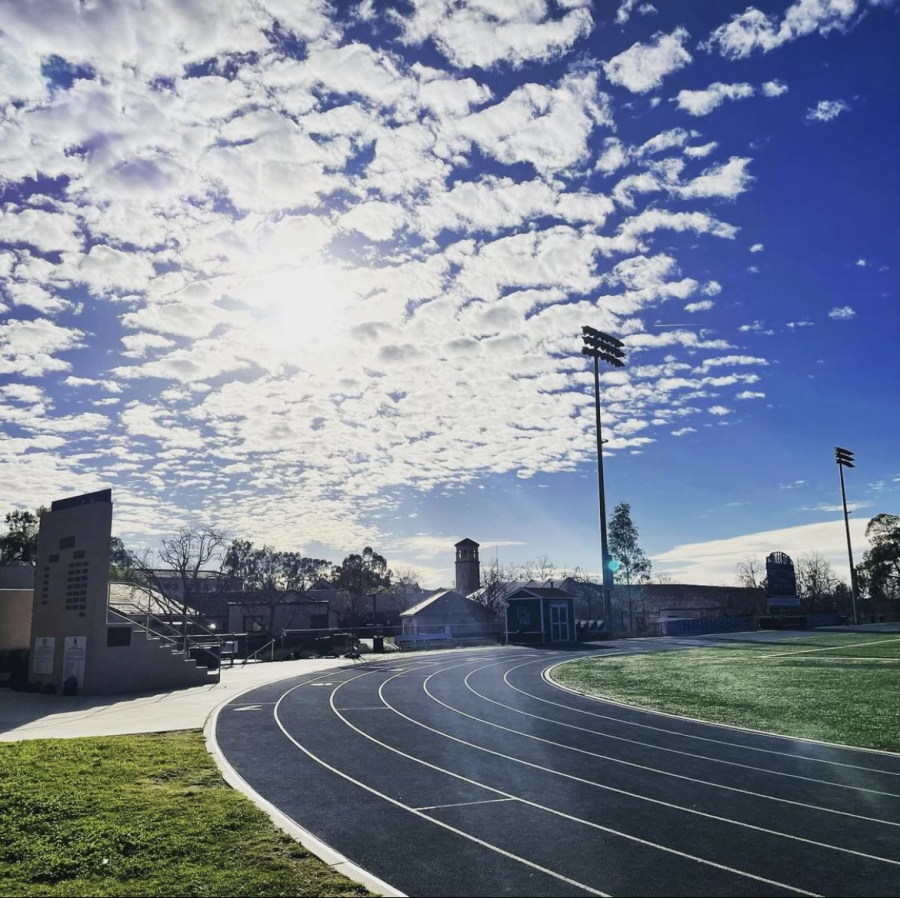 A sunny day sheds light on the track and the happy runners. The students have waited for months for their season to start.