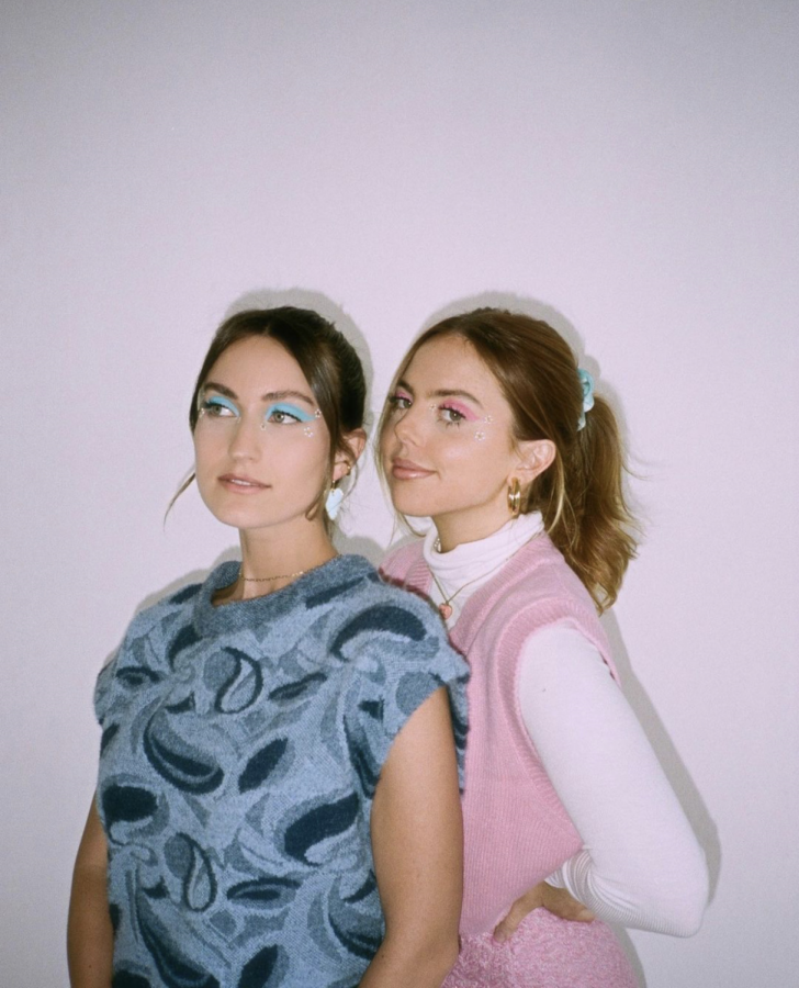 Trendy - Known for their iconic blue and pink outfits, Chelsey and Jaci pose in matching sweater vests. Their friendship started as just 15 year old's in high school.
